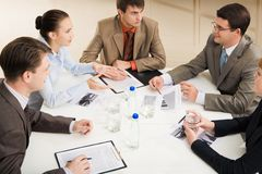 At round table Stock Images