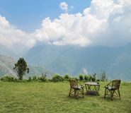 Round table and armchairs with view on the Himalaya Annapurna range royalty free stock image