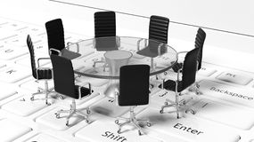 Round table with black leather chairs around it Stock Photos