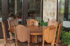 Round table and chairs on front porch. Lakeside settlement landscape. Eastern Europe. Lake house Royalty Free Stock Image