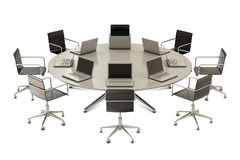 Round table with chairs and laptops Stock Photos