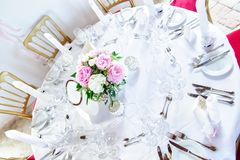 Round Table decorated with Flowers Royalty Free Stock Images
