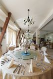 Round table in elegant restaurant Royalty Free Stock Photos