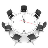 Round table with a large clock face Royalty Free Stock Photo