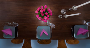 Round table modern serving. Serving with pink napkins and matching flower from top Stock Images