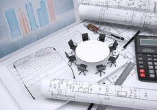 Round table, scrolled drawing, glasses, laptop,. Miniature round table with chairs scrolled drawing and glasses on laptop keyboard, calculator and a few other Royalty Free Stock Photo
