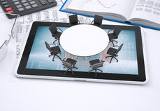 Round table, tablet pc, book, calculator, glasses Royalty Free Stock Photo