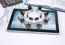 Round table, tablet pc, book, calculator, glasses Stock Photo