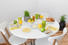 Round table with tasty breakfast Royalty Free Stock Photography