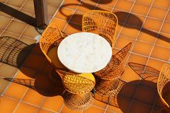 Round table and wicker chairs Royalty Free Stock Photos