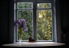 Round table by the window in old fashion country house in forest. At farm in russia ussr Royalty Free Stock Image