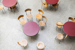 Round tables and chairs in an empty cafe interior Stock Images