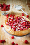 Round tart with fresh raspberries. Food close up Royalty Free Stock Image