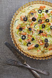 A round tart with salmon and vegetables Royalty Free Stock Image