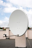 Round television antenna for television on roof of the building Stock Image