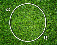 Round Text Box and Quotation Mark. On green grass background, communication concept Stock Image