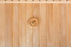 Round thermometer on the wall of wooden sauna Stock Photo