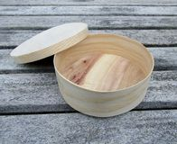 Round thin wooden box with lid Royalty Free Stock Image
