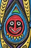 Round Tiki Man. Tiki man face, carved on wood Royalty Free Stock Image