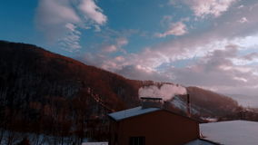 Round time lapse. Winter landscape. Village. From the chimney smoke coming out of house stock footage