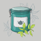 Round tin packaging. And green tea leaves Royalty Free Stock Photography