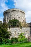 Round Tower with a raised flag in Windsor Castle, England Royalty Free Stock Image