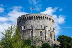 Round Tower with a raised flag in Windsor Castle, England Stock Photo