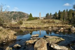 Round Tower Reflection in Glendalough. Reflection in the stream passing the historical monastic site of Glendalough in county Wicklow in Ireland`s ancient east royalty free stock photo
