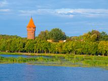 Round tower at the river Royalty Free Stock Photography