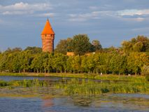 Round tower at the river Royalty Free Stock Photo