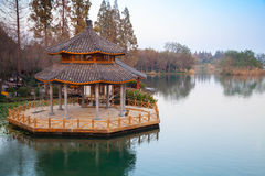 Round traditional Chinese wooden gazebo on the coast Stock Images