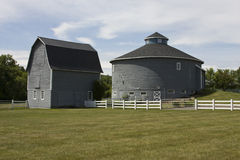 Round and traditional country barns Royalty Free Stock Images