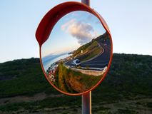 Round traffic mirror reflecting street and city royalty free stock image