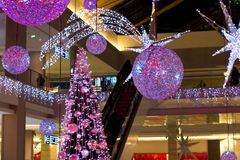 Round transparent ball hanging on the ceiling. New year and Christmas holiday royalty free stock photo