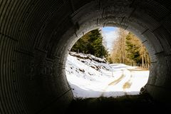 Round tunnel for cars, pedestrians and skiers in a ski resort. stock photography