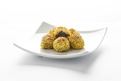 Round Turkish dessert with sesame seeds and dates Stock Images