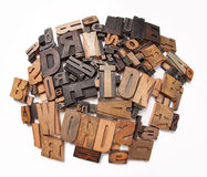 Round typescript background. Wooden typescript letters against a white background Stock Photos
