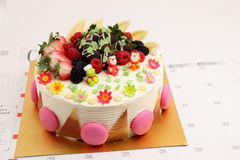 Round vanilla cake decorated with fresh fruits Royalty Free Stock Photography