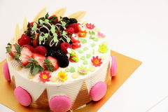 Round vanilla cake decorated with fresh fruits Royalty Free Stock Image