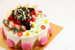 Round vanilla cake decorated with fresh fruits Royalty Free Stock Image