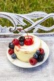 Round vanilla cake decorated with fresh fruits Stock Photo