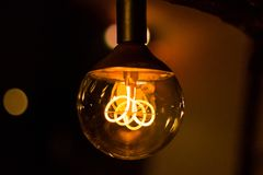 Round vintage lightbulb with glowing wire royalty free stock photo