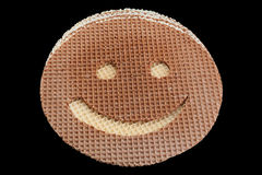Round wafer carved smile Royalty Free Stock Image