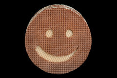 Round wafer carved smile Stock Images