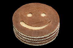 Round wafer carved smile Stock Photography