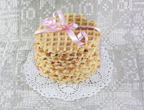 Round wafers tied with a pink ribbon Stock Photography