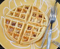 Round waffle with syrup on dish Royalty Free Stock Image