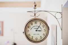 Round wall clock is attached to the wall. Horizontal frame. Round wall clock is attached to the wall Royalty Free Stock Image