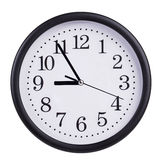 Round wall clock shows five to nine Stock Photo