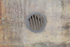 From the round wall grille ventilation. The ventilation grille in the wall Stock Photos